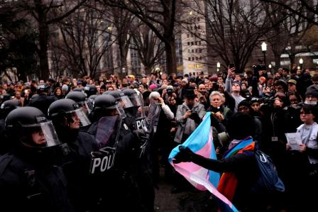 Protesters confront riot police